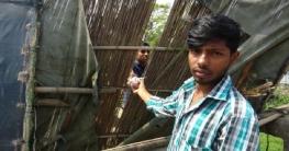 মাদারীপুরের লকডাউন: বেড়ার ফাঁকে পণ্য বিক্রি